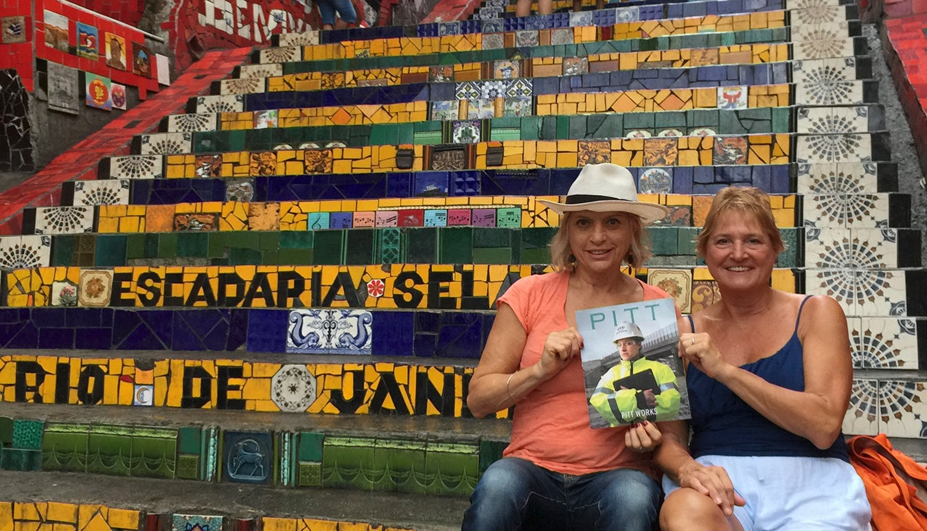 Christine Palamidessi (A&S '73) and Patricia Borneman DiNardo (NURS '78) pause for a moment on the Selaron Steps in Rio de Janeiro, Brazil, to show their favorite traveling companion, Pitt Magazine.