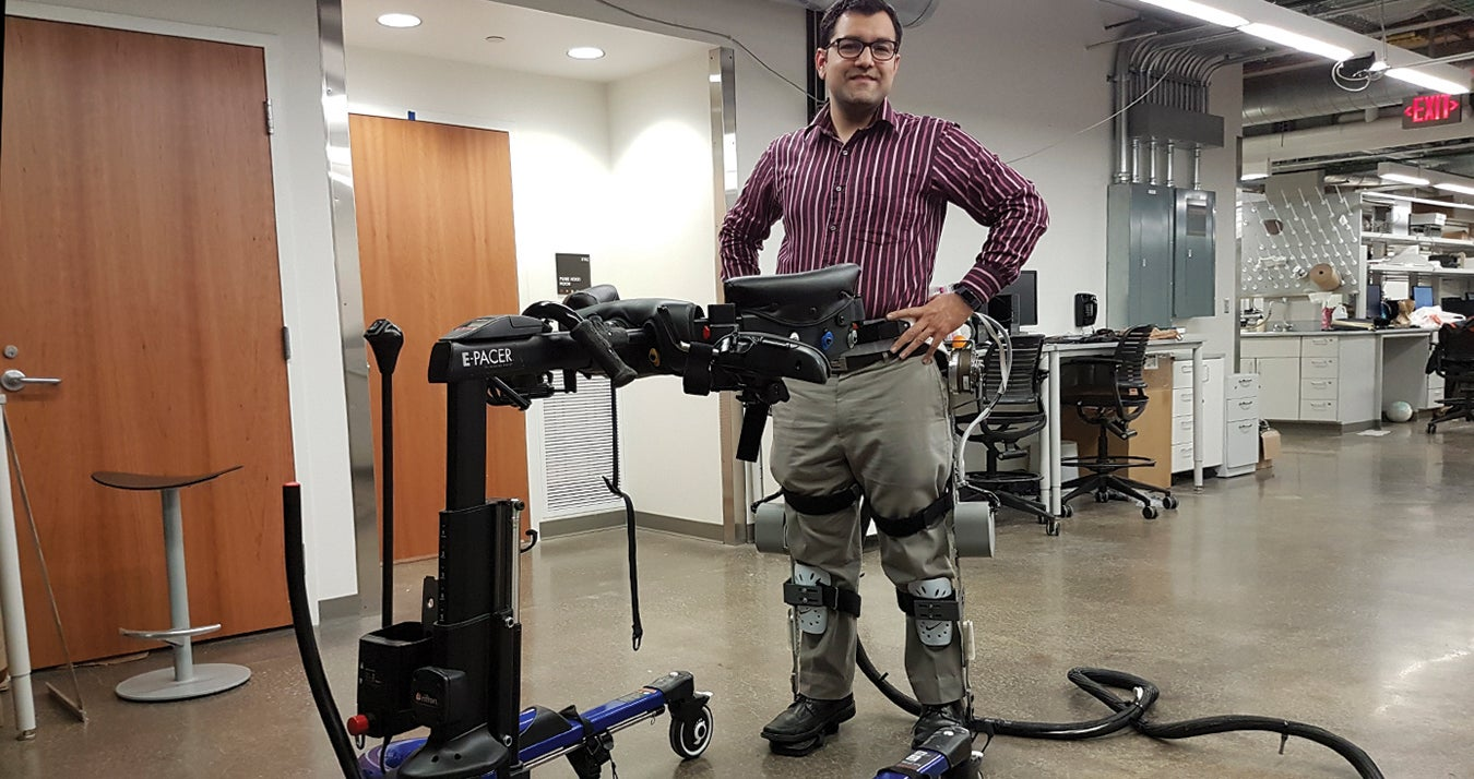 Sharma wearing exoskeleton