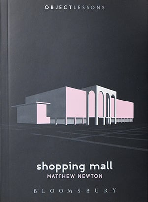 Book cover of Shopping Mall, black background with pink indoor mall structure