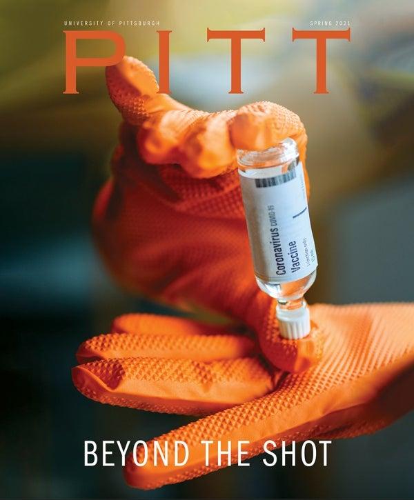 Pitt Magazine cover, Beyond the Shot, featuring orange gloves holding small vial of coronavirus vaccine