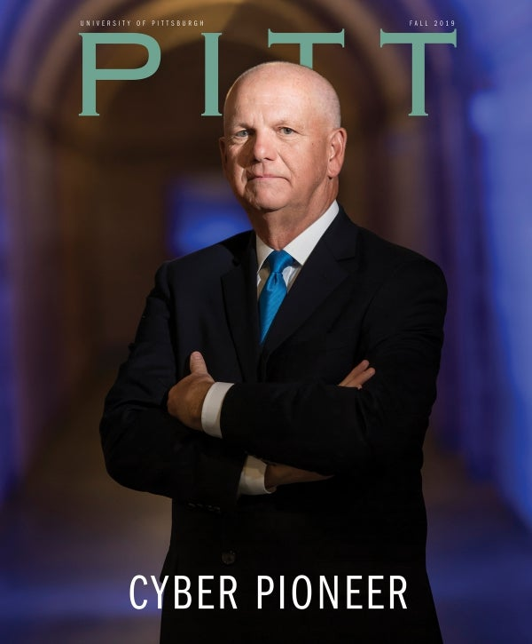 Pitt Magazine Fall 2019 cover, Cyber Pioneer (portrait of David Hickton in the Cathedral of Learning)