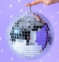 A disco ball held aloft by one finger