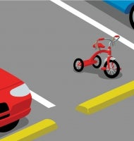 A red tricycle with streamers sits in a parking space between a blue car and a white car.