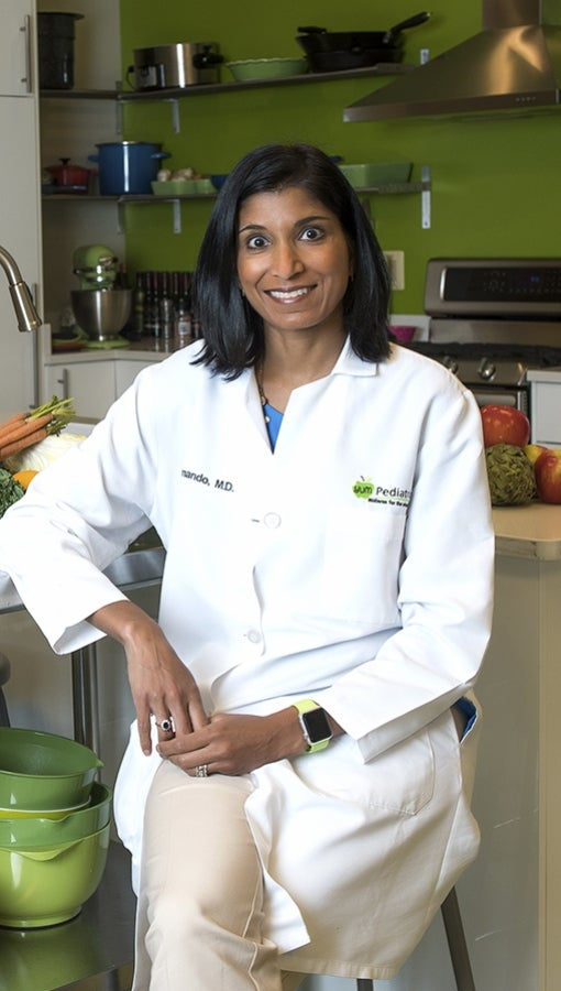 Nimali Fernando, aka Dr. Yum, sits in her office kitchen.