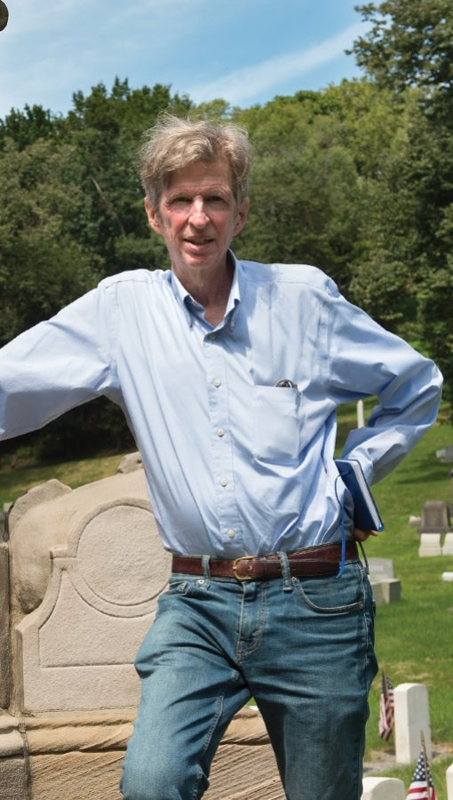Kirk Savage stands in Allegheny cemetery, where he has previously conducted research on representations of race in monuments.