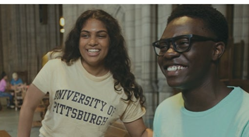 young woman wearing University of Pittsburgh T-shirt and young man wearing mint green shirt