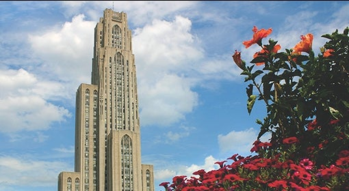 Cathedral of Learning flanked by summertime flowers