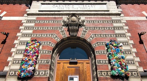 Carnegie Library of Pittsburgh in Lawrenceville, decorated with handmade, multicolor flowers