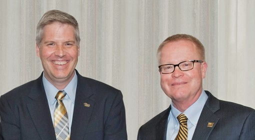 Brownlee (right) with Chancellor Patrick Gallagher