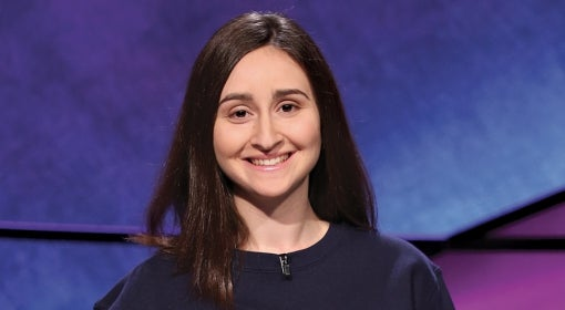 Sarah Dubnik in a Pitt script sweatshirt on the set of Jeopardy!