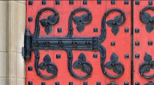 red door with black hardware, leaf motif
