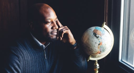Kenyon Bonner looks out the window, a globe sitting on the window ledge