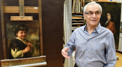 Costas Karakatsanis stands next to and discusses the 18th-century painting Shepard Boy with Recording at the Carnegie Museum of Art in Pittsburgh.