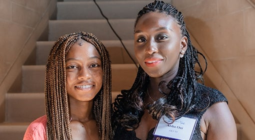 Omolara Oni and Aisha Shettima in front of steps in Heinz Memorial Chapel