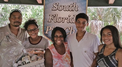 The Addison Family poses for a photo at the South Florida Pitt Club's freshman Send-Off event.