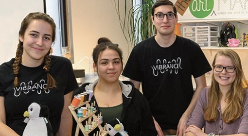 The team, from left: Jocelyn Dunlap, Natalie Neal, Jesse Rosenfeld, Caroline Westrick, Samosky, Issam Abushaban and Thomas Driscoll in the Art of Making studio, with backpack monkeys, electronics, fabric, spools of thread spread out on a table