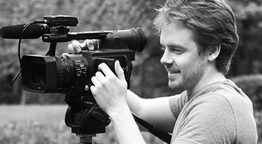 Tom Getty handles a movie camera on set