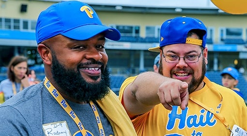 odney Hill (UPJ '07) and Steve Harrison (right) get pumped up before the 100th meeting of Pitt and Penn State at the Pitt Alumni Association Tailgate, one of the football tailgate events hosted by the PAA each year.