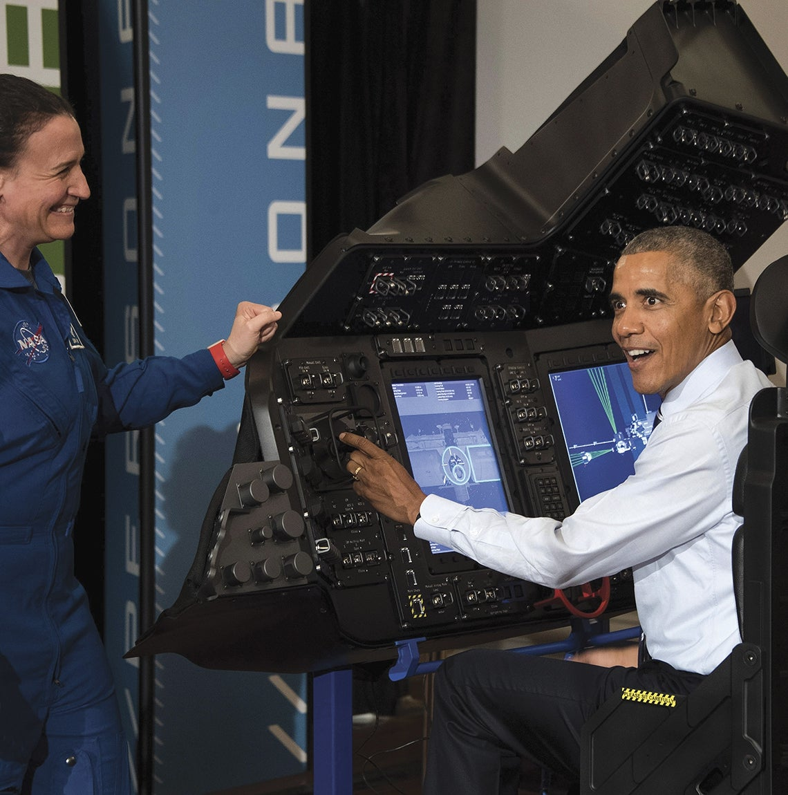 President Obama interacts with NASA equipment.